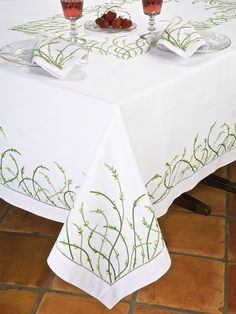 Jardin D'Amour - Luxury Table Cloths - The most graceful flowers you can pick for your table are hand embroidered in Yellow on tall, willowy stems in two shades of Green