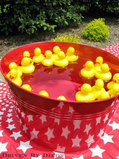 Maybe a game for the kids? Put a pink or blue dot underneath each duck. Each child can pick up two ducks. If they make a match, they win a prize.