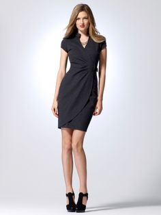Cap sleeve ponte faux wrap dress with band collar and snap detail. Hardware buckle. 36% polyester, 34% rayon, 20% nylon, 10% spandexDomesticDry clean