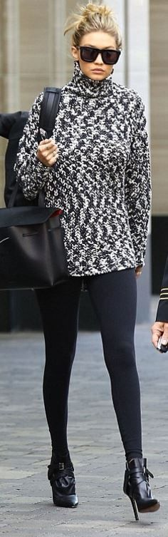 Who made  Gigi Hadid's black leggings, gray sweater, sunglasses, Iphone case, and black leather backpack?