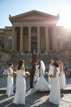 Destination wedding in Sicily. bridesmaids wearing various long chiffon dresses from Ceremony by Joanna August in the color Going to the Chapel.