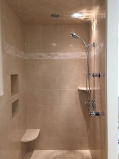 This walk-in shower features two body sprays and an inset rain shower head in the ceiling. The two cubbies and the corner shelf provide extra storage. By Michael James Design, Inc. Rustic Bathroom Decor, Rustic Decor, Walk In Shower, Rain Shower, Rustic Bench, Wet Bars, Diy Mirror, Black Decor, Diy On A Budget