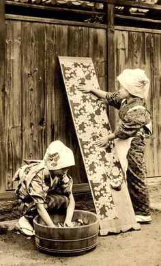 """Photo, late 19th century, Japan. Photographer unknown. """"In the past, a kimono would often be entirely taken apart for washing, and then re-sewn for wearing. This traditional washing method is called 'arai hari.' Because the stitches must be taken out for washing, traditional kimonos needed to be hand sewn. Arai hari is very expensive and difficult and is now only done for high-end garments"""". Image owned by Okinawa Soba,"""