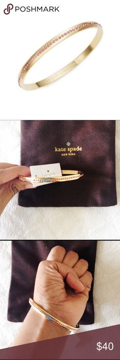 Kate Spade pink rhinestone bracelet  authentic  • new with tags • gold tone with pink rhinestones  • comes w/ KS dustbag ❌ no trades  ❣️offers welcome! kate spade Jewelry Bracelets