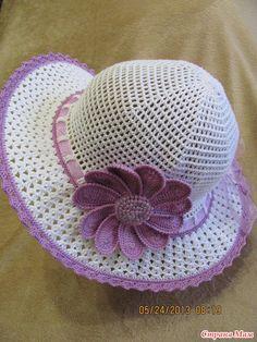 Sombrero del verano con la flor