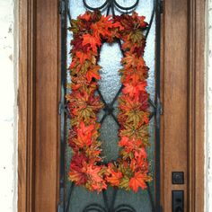 I used PVC pipe to make a rectangle the size wreath I wanted and spray painted it brown. Then hot glued fall leaves to it.