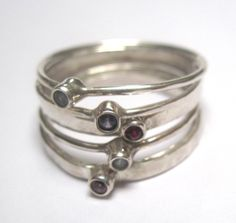 Family Birthstone Rings. Wear a delicate collection of semi-precious stones on your finger to remind you of those you love. www.wishdesignshop.com  300