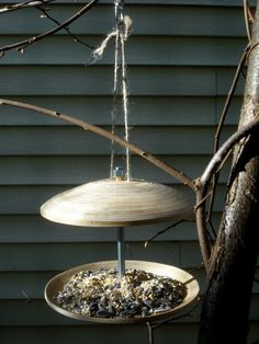 Make an easy bird feeder out of Ikea bamboo plates. Perfect for sprucing up your garden while feeding our feathered friends.