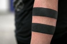 tattoo  bars  bands  armband  blackwork I love this kind of tattoo for some reason. It looks like it would take a while though. I think it would be fun to have one wide band, and two mirrored Celtic knots that twisted around the arm around the band.