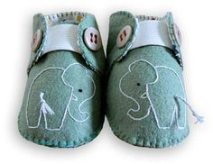 felt turquoise baby elephants with light blue tassel tails & grey buttons & grey elastic front