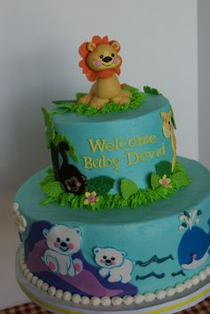 baby boy shower zoo animal cake - buttercream iced cake with fondant decorations