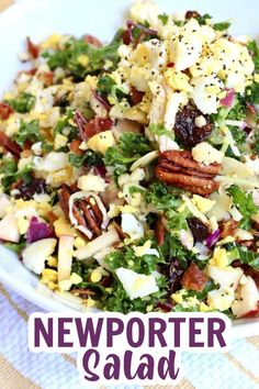 This Newport Salad is packed with chopped kale, roasted chicken, fresh apple, red onion, egg, bacon, cherries, pecans, almonds and white cheddar all tossed in a light champagne vinaigrette. Salad dreams do come true! #salad #newportersalad