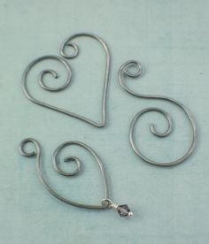 These handcrafted charm holders are perfect for many jewelry creations! They are hand forged from 14 gauge solid metal wire and polished to a