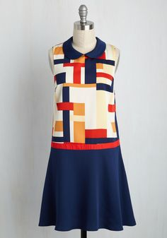 Your coworkers will sing a 'song of nice and fire' every morning that this drop waist dress soars through the office. Part of our ModCloth namesake label, this collared frock - touting a navy, red, ivory, and pale yellow colorblock print - declares your arrival with stylish precedence.