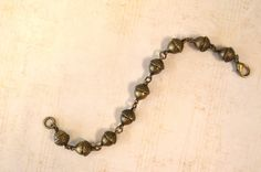 Antiqued Brass Acorn Bead Bracelet by skyeshouse on Etsy, $10.00