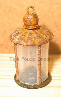 Miniature rusted lantern ~ not a complete tutorial but lists the parts which start from rusted nails and repurposed jewellery parts  | Source: Le Reve Tom Pouce