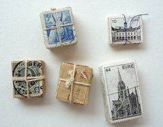 Darling little bungles of postage stamps tied up with string. *love*