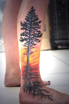 Sun set tattoo idea and tree on thigh