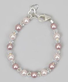 Esta pulsera Adorable se realiza mediante pearsl/cristales de swarovski Rosa y rosa y cristal claro plata esterlina extensores y crecer con la mano del niño.  Esta pulsera se verá como 1 millón por parte del bebé. Las perlas se encadenan en 49 hebras de alambre de la joyería. Cada