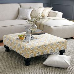 Easy to DIY- build frame, add cushion and use staple gun to cover with fabric. Then, add furniture legs.