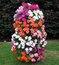 Flower Tower - Freestanding Vertical Planter A freestanding vertical planter that lets you take your flower garden to new heights and save space as well. Vertical Planter, Vertical Gardens, Tower Garden, Garden Art, Plant Tower, Planter Garden, Spring Garden, Lawn And Garden, Big Garden
