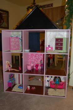 diy dvd shelf to barbie doll house | For a roof, we used a flag case from Michael's craft store.