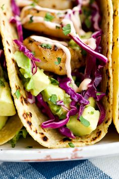 Recipe:  Honey Lime Tequila Shrimp Tacos with Avocado, Purple Slaw and Chipotle Crema