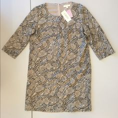 """NEW W/ TAGS Erin Fetherston Sequin Party Dress Brand New Erin Fetherston Shift Dress in ecru/ivory in size 12 / L. This dress has a black and silver floral sequin detail, and a subtle floral and abstract bird pattern in the stitching.  - Fully-lined - 3/4 sleeve - Above the knee hem - Concealed zipper down the back - Never worn, still has tags attached  Measurements - Shoulder to hem: approx. 37"""" - Shoulder to shoulder: approx. 16.5"""" - Across the bust: approx. 21.5""""  This dress is an…"""