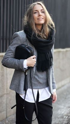 black trouser pants, white button up, grey sweater and coat w/ a scarf