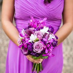 Each bridesmaid carried a gorgeous gathering of roses, orchids, calla lilies and freesia.
