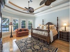 Pretty blue traditional bedroom on the Water in Park Shore, Naples, Florida
