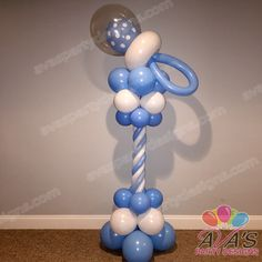 Get mom-to-be all the decor essentials needed at a baby shower with this Baby Pacifier Balloon Column. #partywithballoons