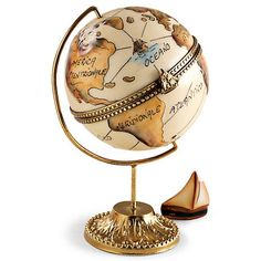 Limoges Globe Box .... on brass stand, with brass stand and sailboat clasp at equator line, compass points painted inside, removable ship