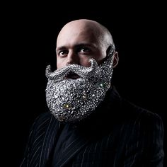A crystal beard by Dominic Wilcox, which is displayed alongside other absurd inventions in Selfridges' window