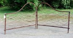 Early wrought iron double gate with curved top rail on