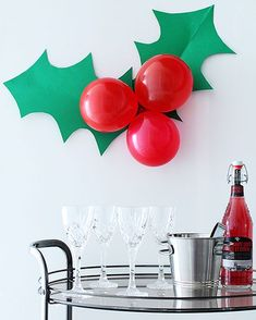 Festive Holly Decoration A giant sprig of holly to decorate for your next holiday party!A giant sprig of holly to decorate for your next holiday party! Simple Christmas, Christmas Holidays, Christmas Crafts, Diy Christmas Party Decorations, Work Christmas Party Ideas, Christmas Decorations Apartment Small Spaces, Outdoor Christmas, Christmas Backdrop Diy, Holly Christmas