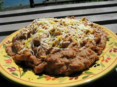 Easy Refried Refried Beans from Food.com:   My sister-in-law who was born and raised in Mexico City shared this recipe for sprucing up canned refried beans. They taste like you've been cooking them for hours.