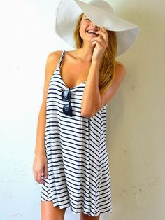 Gorgeous summer white  black stripes cute dress with light grey huge beach cap the best street style  summer beach outfits