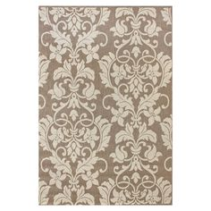 Add a lovely touch to your patio or den with this artfully crafted indoor/outdoor rug, showcasing a scrolling acanthus leaf motif in a neutral palette.