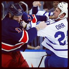 Colton Orr drops the mitts with Mike Rupp