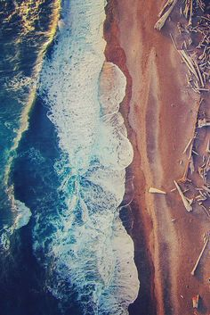 Dirk Dallas  A birds eye view, seeing the layers of colours contrasting, giving a more realistic idea of how the ocean and the land meet