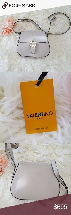 NWT Authentic Taupe Valentino Bag Authentic taupe colored leather Valentino crossbody made in Italy. Comes with dustbag. Gold tone accents. Gooooorgeous!!!😍😍😍 *Open to offers Valentino Bags Crossbody Bags