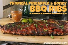 Tropical Pineapple & Honey BBQ Ribs, an easy ribs recipe with honey BBQ sauce, pineapple, lime, Caribbean seasoning, and cilantro.