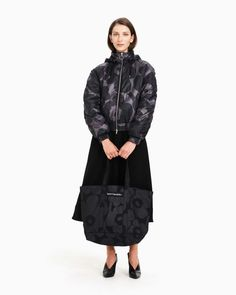 The black and dark grey Unikko pattern decorates the short Viittaus lightweight wadded jacket, which has a pink inner lining. The jacket has a metal zipper with a ring puller,broad welt pockets at the front and a detachable hood with drawstrings and a zip Normal Body, Dark Grey Color, Marimekko, Welt Pocket, Ready To Wear, Winter Jackets, Female, Sleeves, How To Wear