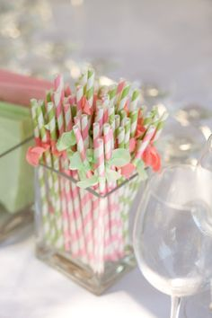 Pink and green striped straws.