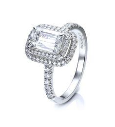 Double Vintage Ashoka Diamond Ring. Ashoka and round-brilliant cut diamonds in platinum