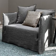 """Wij maken ook allerlei soorten hoezen over meubelen en kussens, zogenaamde """"slipcovers"""""""