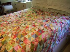 Love this scrappy half-square triangle quilt