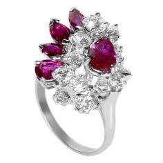 Oscar Heyman Ruby Diamond Platinum Cluster Ring   From a unique collection of vintage cluster rings at http://www.1stdibs.com/jewelry/rings/cluster-rings/