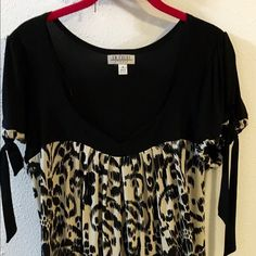 Comfortable black and beige dress. Never used. Made in Indonesia, cute dress. I loved it but it was to big for me. En Focus Dresses Midi